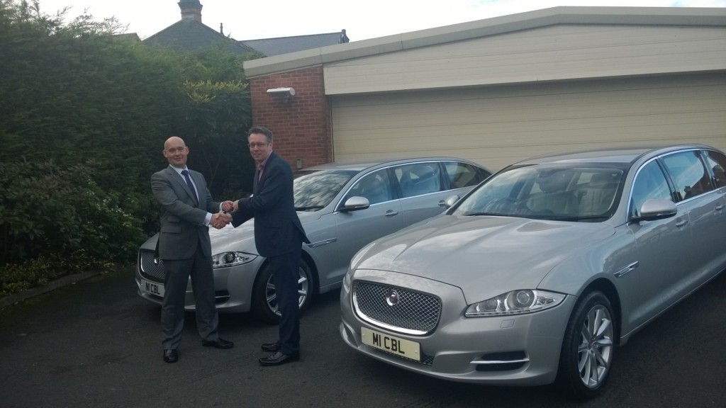 Wilcox delivers two new Jaguar Limousines to Bastock.